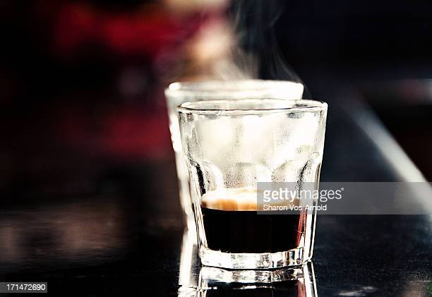 2 steaming espresso shots in glasses