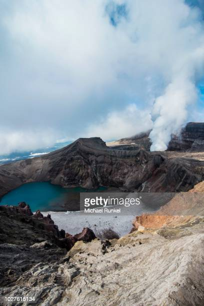 Steaming fumarole with crater lake on the Gorely volcano, Kamchatka, Russia