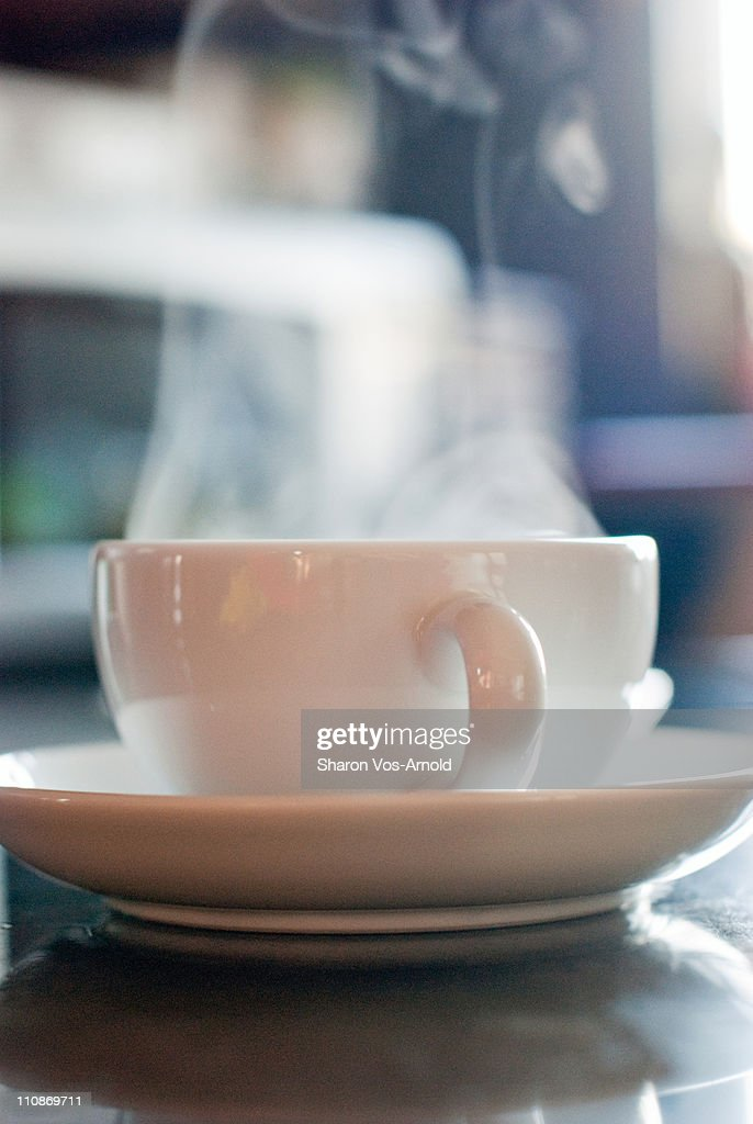 Steaming hot, white china cup of coffee : Foto de stock