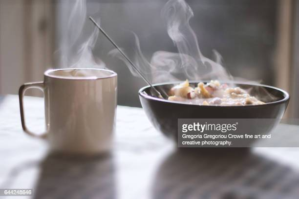 steaming porridge and tea - hot tea stock pictures, royalty-free photos & images