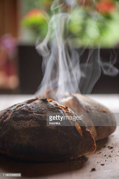 steaming sourdough - loaf of bread stock pictures, royalty-free photos & images