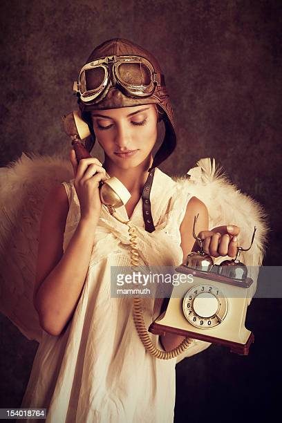 steampunk angel talking on the phone