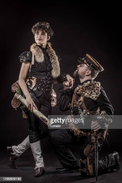 steampunk couple in a studio shot - major stock pictures, royalty-free photos & images