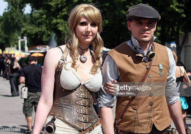 Steampunk enthusiasts walk through the annual WaveGotikTreffen music festival on May 26 2012 in Leipzig Germany The event began in the 1990s and has...