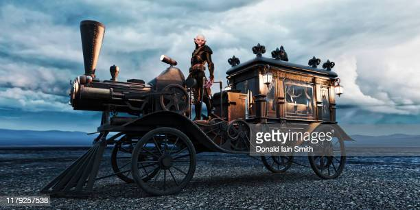 steampunk hearse with vampire driver - hearse stock photos and pictures