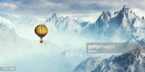Steampunk hot air ballon flying over winter alpine mountain region