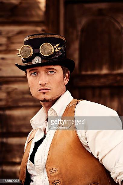 Steampunk - Man With Top Hat Goggles and Leather Vest