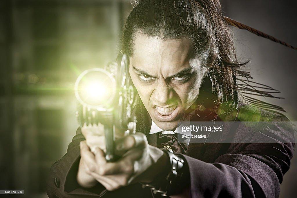Steampunk Warrior Shooting Ray Gun : Stock Photo