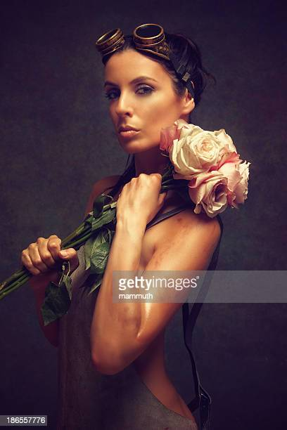 steampunk woman holding a bouquet of roses
