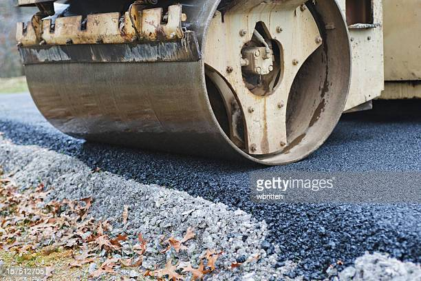 Steamroller Paving Road with Asphalt