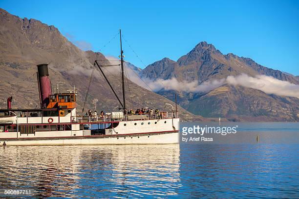 Steamship Cruising Past Mountain Background