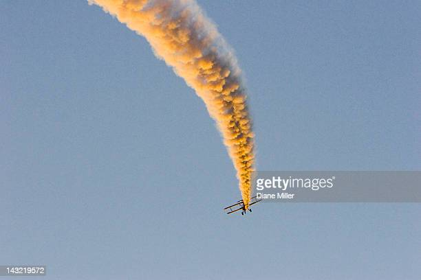 1943 stearman biplane with airshow smoke - 1943 stock pictures, royalty-free photos & images