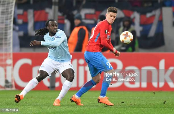 Steaua Bucharest's forward from Romania Dennis Man fights for the ball with Lazio's defender from Belgium Jordan Lukaku during their UEFA round of 32...