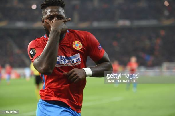 Steaua Bucharest's French forward Harlem Gnohere celebrates after scoring during the UEFA Europa League round of 32 first leg football match Steaua...