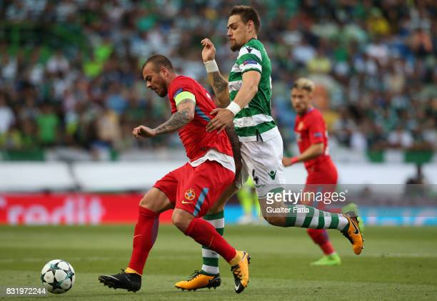 Steaua Bucuresti FC forward Denis Alibec from Romania with Sporting CP defender Sebastian Coates from Uruguay during the UEFA Champions League...