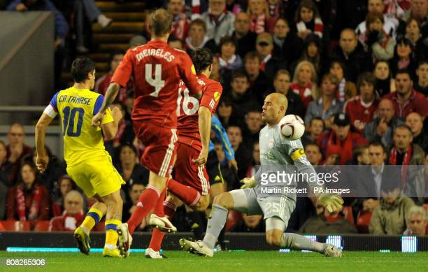 FC Steaua Bucuresti's Cristian Tanase scores past Liverpool goal keeper Pepe Reina during the UEFA Europa League match at Anfield Liverpool