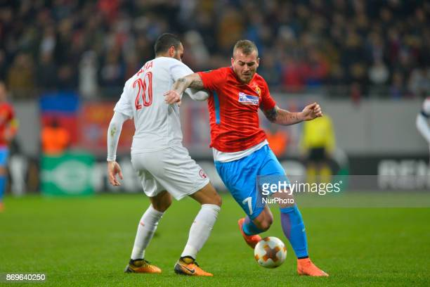 Steaua's Denis Alibec vies Hapoel's Loai Taha during the UEFA Europa League 20172018 Group Stage Groupe G game between FCSB Bucharest and Hapoel...