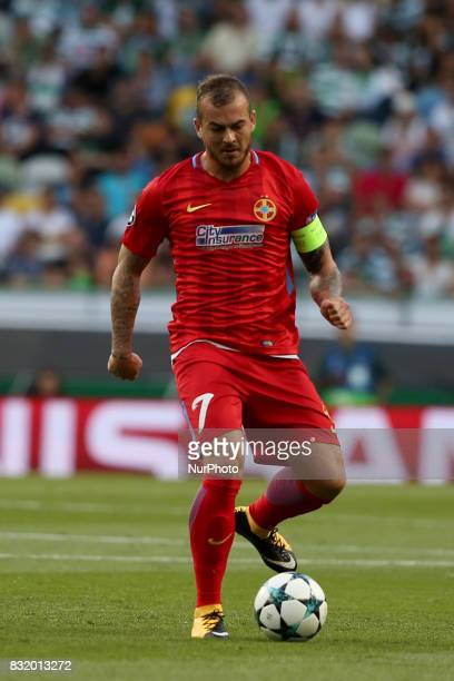 Steaua's forward Denis Alibec in action during the UEFA Champions League playoffs first leg football match between Sporting CP and FC Steaua...