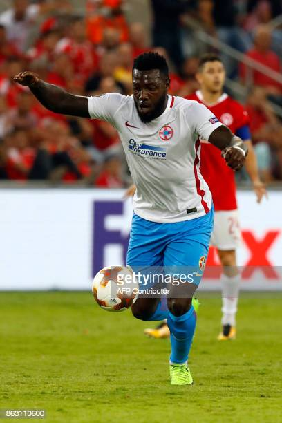 Steaua's French forward Harlem Gnohere shoots to score during the UEFA Europa League Group G football match between Hapoel BeerSheva FC and FC Steaua...