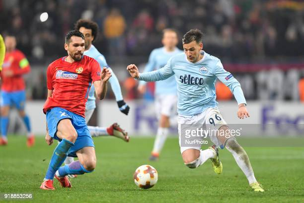 Steaua's Valerica Gaman compete for the ball with Lazio's Alessandro Murgia during UEFA Europa League Round of 32 match between Steaua Bucharest and...