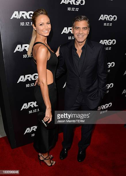 Stecy Keibler and actor George Clooney arrive at the premiere of Warner Bros Pictures' Argo at AMPAS Samuel Goldwyn Theater on October 4 2012 in...