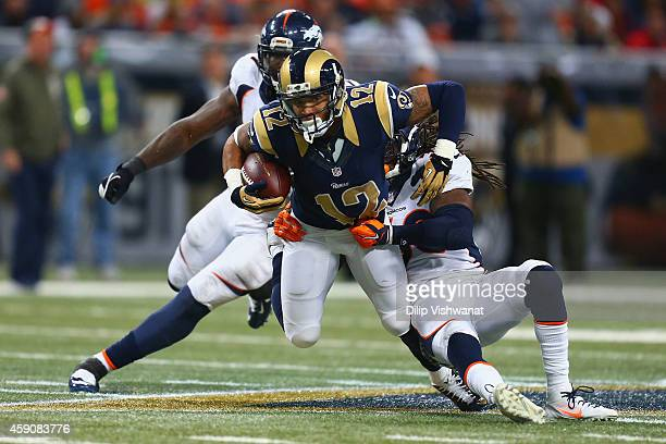 Stedman Bailey of the St Louis Rams is tackled after making a catch against the Denver Broncos in the fourth quarter at the Edward Jones Dome on...