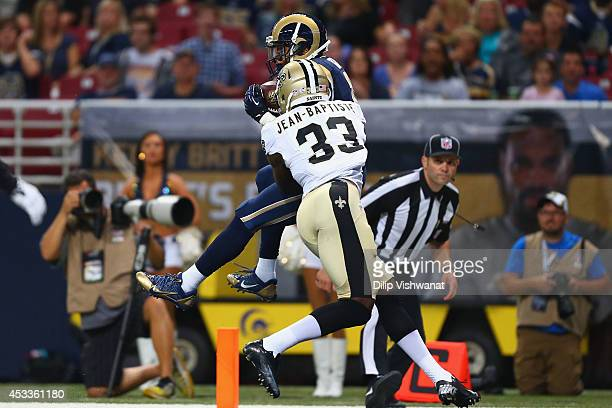 Stedman Bailey of the St Louis Rams makes a touchdown catch against Stan JeanBaptiste of the New Orleans Saints during the first half of a preseason...