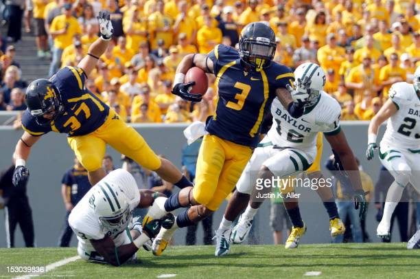 Stedman Bailey of the West Virginia Mountaineers carries the ball on a kick off against the Baylor Bears during the game on September 29 2012 at...