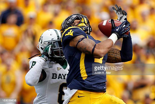 Stedman Bailey of the West Virginia Mountaineers catches a forty seven yard touchdown pass in the first half against KJ Morton of the Baylor Bears...