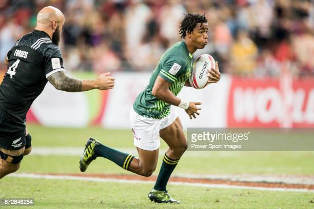 StedmanGhee Gans of South Africa runs with the ball during the match South Africa vs New Zealand Day 2 of the HSBC Singapore Rugby Sevens as part of...