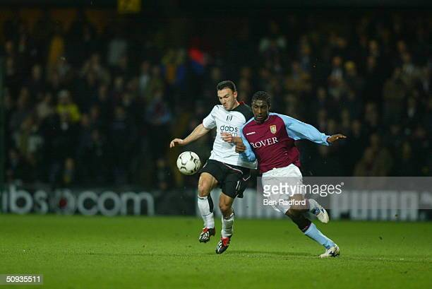 Steed Malbranque of Fulham and Jlloyd Samuel of Aston Villa during the FA Barclaycard Premiership match between Fulham and Aston Villa at Loftus Road...