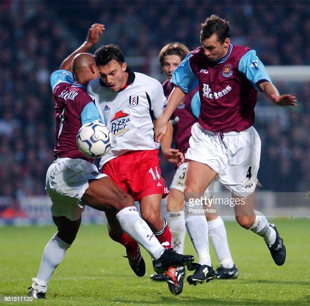 Steed Malbranque of Fulham is halted by Trevor Sinclair and Don Hutchison of West Ham United during the FA Barclaycard Premiership match between West...