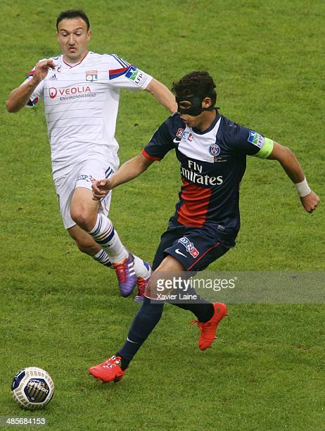 Steed Malbranque of Olympique Lyonnais and Thiago Silva of Paris SaintGermain in action during the French Finale League Cup between Paris...