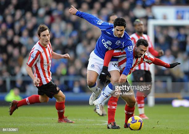Steed Malbranque of Sunderland is challenged by Mikel Arteta of Everton during the Barclays Premier League match between Everton and Sunderland at...