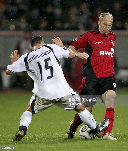 Steed Malbranque of Tottenham challenges Sergej Barbarez of Leverkusen during the UEFA Cup Group B match between Bayer Leverkusen and Tottenham...
