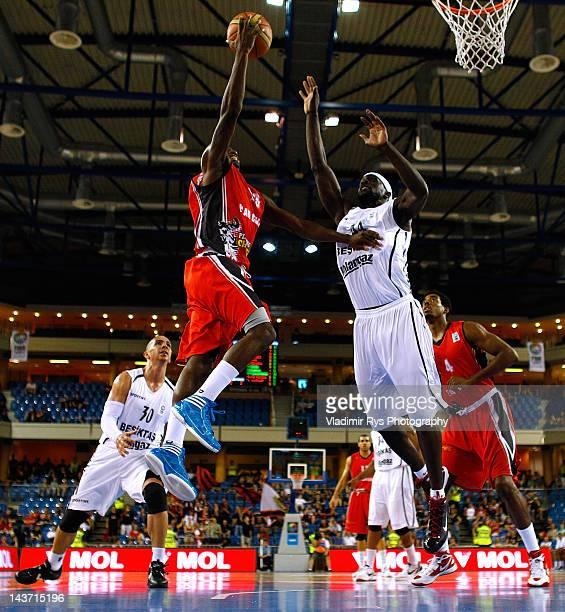 Steed Tchicamboud of Chalon shoots as Pops Mensah-Bonsu of Besiktas defends during the FIBA Europe EuroChallenge Final Four final game between...