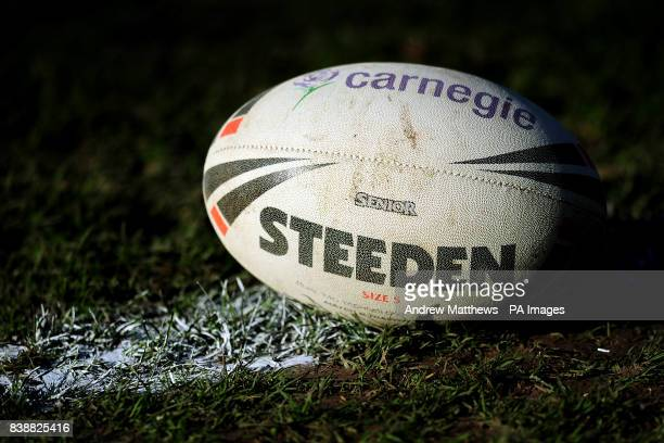 A Steeden Rugby League matchball sits on the pitch
