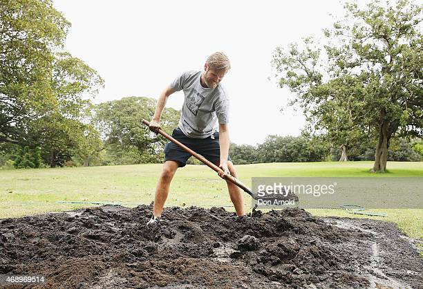 Steege Mathews prepares the pitch just prior to a mud fight to raise awareness about the 'Mud Pie Project' to help raise funds to complete the Ian...