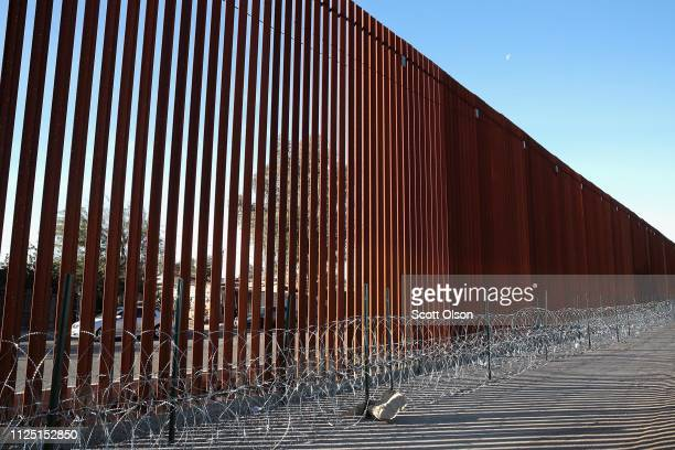 A steel and concertina wire barrier runs along the border of the United States and Mexico on January 26 2019 in Calexico California The US government...