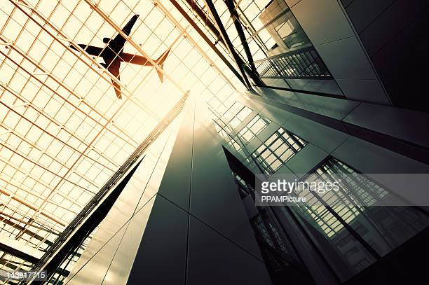 Steel and glass building with a airplane silhouette