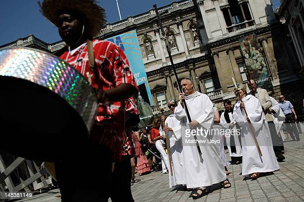 A steel band followed by clergy leads the artists' procession from the Royal Academy of the Art's courtyard to a service held at St James' Church on...