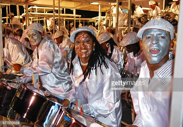 steel band playing in carnival - steel drum stock photos and pictures