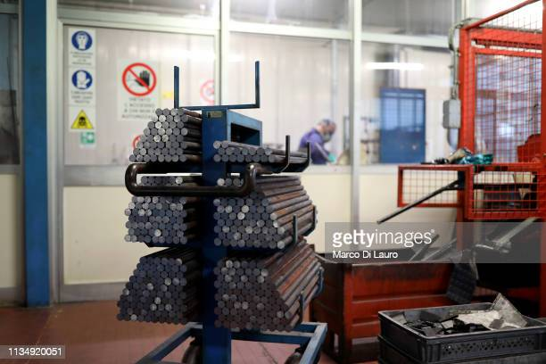 Steel bars that will soon become rifle barrels are seen on April 4 2019 at the Perazzi Armi factory in Botticino Mattina a village in the outskirt of...