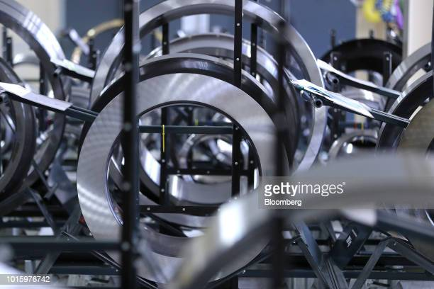 Steel bearing housing rings sit on the assembly line inside the Schaeffler AG factory in Schweinfurt Germany on Tuesday July 3 2018 Schaeffler the...