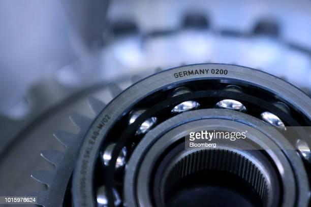 Steel bearings rest inside a electric automobile axle drive gear wheel on the production line in the Schaeffler AG factory in Herzogenaurach Germany...