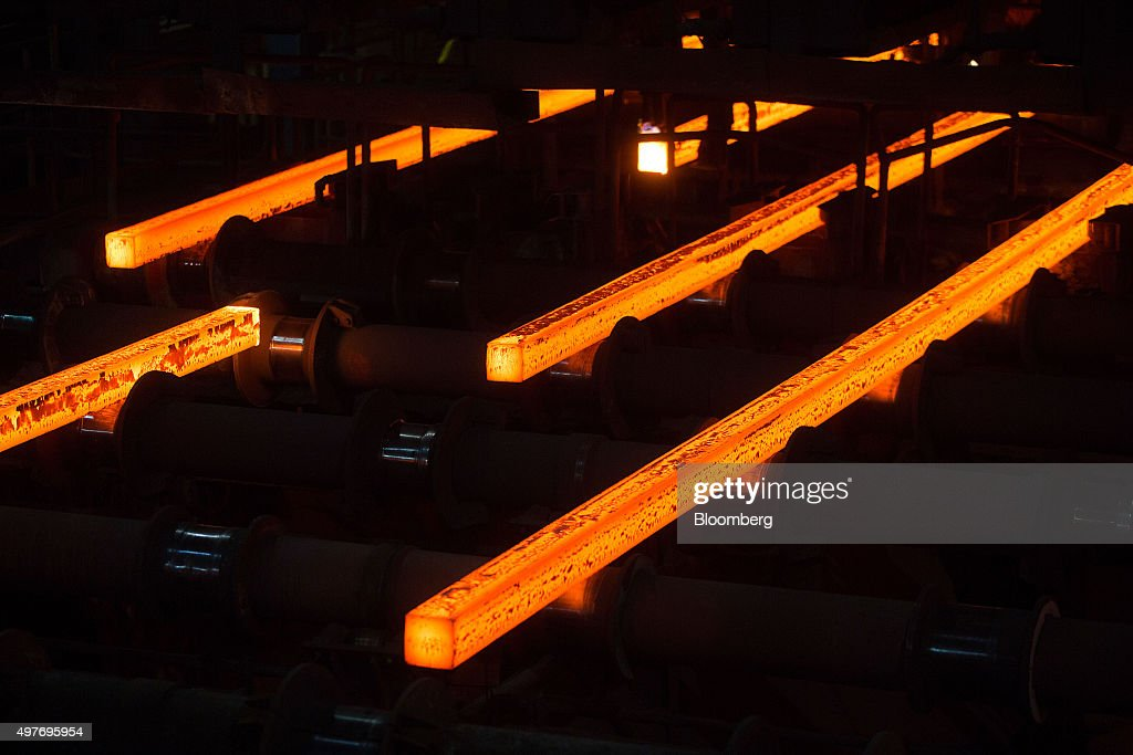 Steel billets move down the production line at the Celsa Steel UK Ltd. steel mill plant in Cardiff, U.K., on Wednesday, Nov. 18, 2015. Iron ore will extend declines into 2016 as weakening steel output hurts demand while the world's biggest suppliers raise production further, according to a former chief economist at Rio Tinto Group, who said China would do well to demolish unneeded mills. Photographer: Simon Dawson/Bloomberg via Getty Images