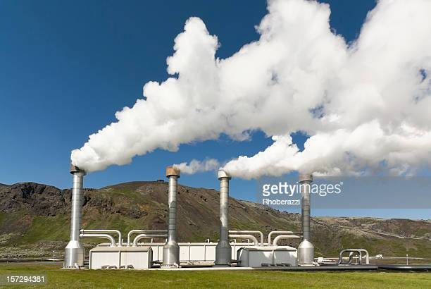 4 steel chimneys with smoke from geothermal energy