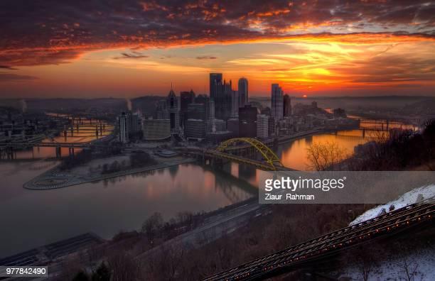 steel city sunrise - ziaur rahman stock pictures, royalty-free photos & images