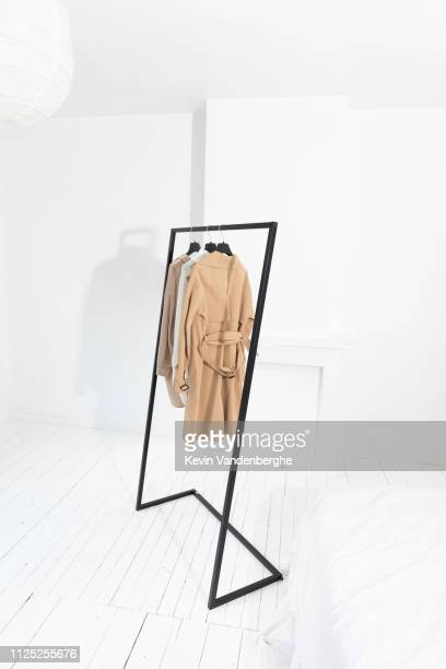 steel clothes rack in white room - clothes rack stock pictures, royalty-free photos & images