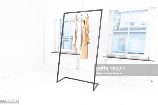steel clothes rack with curtain in white room - 収納ラック ストックフォトと画像